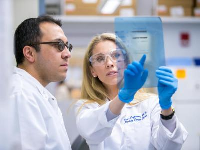 Kate Zaytseva and Naser Jafari studying the importance of an enzyme