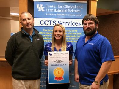 Ickes, center, was selected as winner of the CCTS Science Communication Comic Book Challenge. She is joined by Joel Thompson, PhD, research development director, and Bryan Sanders, marketing assistant and illustrator.