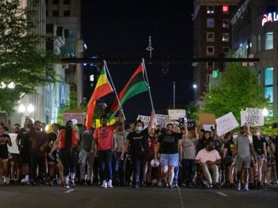 Protesters march through the streets of downtown during the 11th night of protesting police violence in Lexington, Ky., Monday, June 8, 2020. photo by SILAS WALKER, LEXINGTON HERALD-LEADER