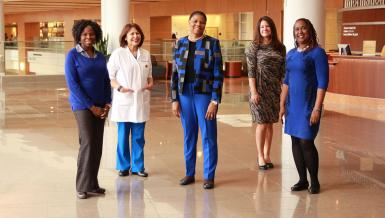 Members of the Disparities Researchers Equalizing Access for Minorities (DREAM) Center, from left to right Adebola Adegboyega, a BSN-PhD student from Nigeria; Assistant Professor Ana Linares; Brenda Combs, program director; Assistant Professor Mollie Aleshire; and Associate Professor Jenna Hatcher who also serves as director of  DREAM and the director of diversity and inclusivity.