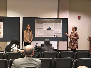 Ashley Gibson and Kacie Bledsoe present their poster.